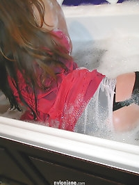 Jane gets in the bath in all her lingerie