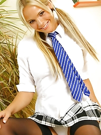 Holly McGuire in college uniform with black holdup stockings