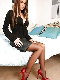 Sexy Gemma Massey wearing leather miniskirt and sexy..