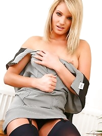 The gorgeous Emma C stripping from her grey Secretary..