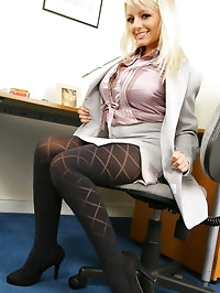 Beautiful blonde in smart secretary outfit with pretty..