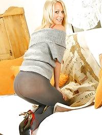Maria Sheriff wearing a grey miniskirt with grey pantyhose..