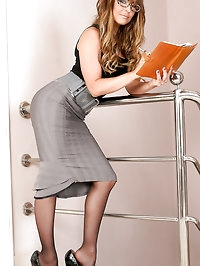 Emma the sexy secretary in stockings wants your dictation