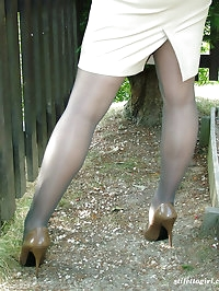 A seriously gorgeous blonde shows off her great legs..