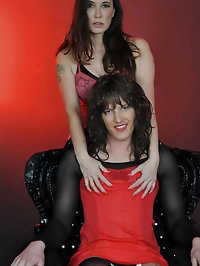 Jane gets on her knees and puts her head between a TGirls..