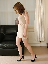 Alison gets your fetish going at home in her silky nylon..