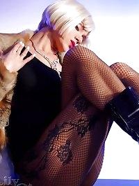 Beautiful leggy MILF whore in black fishnet pantyhose and..