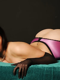 Paige is wearing some gorgeous purple lingerie that shows..