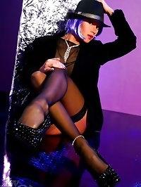 Sexy leggy Milf in black stockings and stilettos