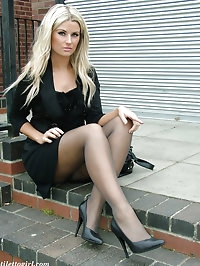 Beautiful blonde dressed in black and showing off her high..