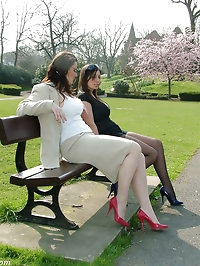 Two horny girls outside wearing short skirts and sexy nylons