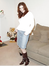Beauty in jeans skirt and long boots