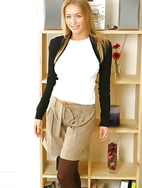 Sexy Hayley-Marie wearing shorts with brown pantyhose with..