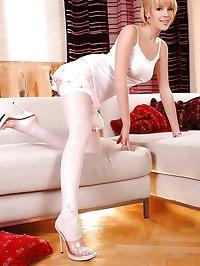 Innocent blonde teen in stockings