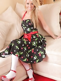 Pretty blonde looks amazing in her summer dress and candy..
