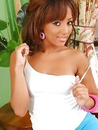 Naughty brunette looks stunning in her tight white vest..
