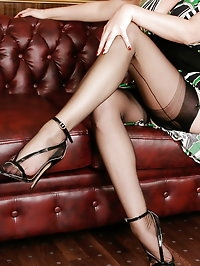 Alina posing on leather sofa and shows her long sexy legs..