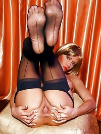 Legs and feet action of hot MILF in sheer black stockings
