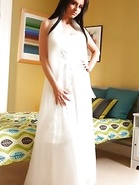 Beautiful bride slips out of her elegant white dress and..