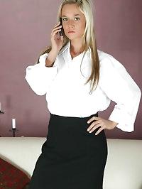 Carman K dressed as a sexy secretary in a white shirt,..