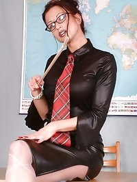 busty black vinyl dildo teacher in pantyhose