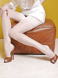 Alina posing in sexy stockings and high heels