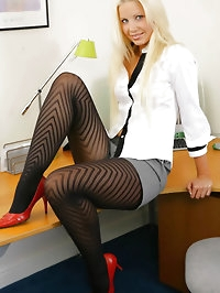 Gorgeous blonde secretary in smart shorts and black..