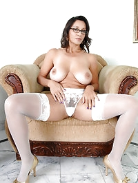 Naked Anilos milf shows off her big tits while busy..