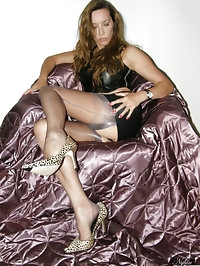 Jane at home in sexy leather mini skirt and stockings