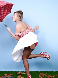 A naughty autumn wind blows away all Kelli Smith's clothes.