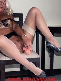 Leggy Lana enjoys some phone sex and a dildo