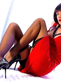 Glamour leggy Milf in black stockings and sexy stiletos