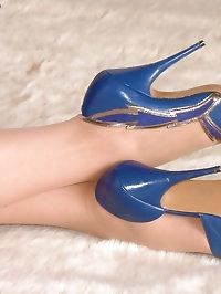 These are some beautiful blue high heel stilettos worn by..