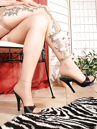 Sweet Nadja wear tan stockings over skin colored pantyhose