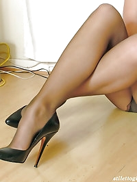 This cheeky blonde looks stunning in black high heels and..