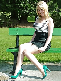 This naughty blonde is wearing a very short skirt and some..