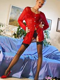 Damn hot MILF long legs in black stockings and red heels