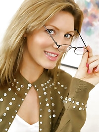 Stunning blonde Nicole in secretary outfit with green..
