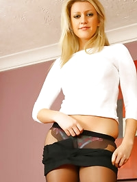 Morgan M is dressed in her secretary outfit; a tight top,..