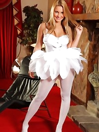 Cheeky blonde looks amazing dressed all in white, in her..