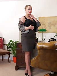 Heres Beth at her desk clad in vintage lingerie with sheer..