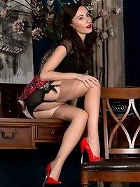 Lady boss, Sophia, does a slow tasteful striptease whilst..