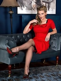 ~ Danielle looking fabulous in a smart red business dress,..
