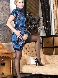 Slinky in oriental dress, Skye strips to reveal a black..