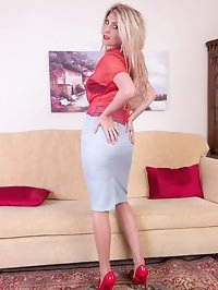 The leggy blonde MILF is sporting sheer red blouse and..