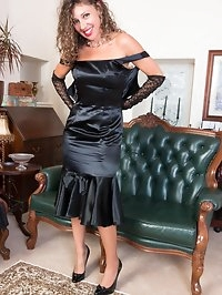 Dressed for a posh dinner in a swish satin gown, Chloe..