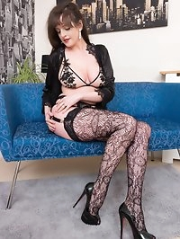 Join busty Kate Anne as she poses on the couch in hot..
