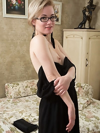 A little black dress hugs Lisa Youngs every slender curve...