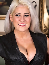 Busty milf Lu Elissa is proud of her all natural huge..