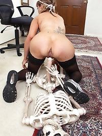 Naughty nurse Christy James bones a skeleton